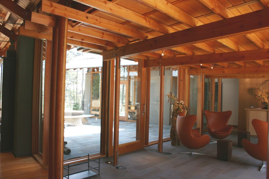Interior shot looking towards courtyard. The doors are designed to blend in seamlessly with the tructural compoents.