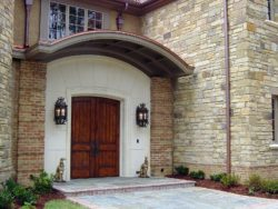 Front entranceway with arched French doors