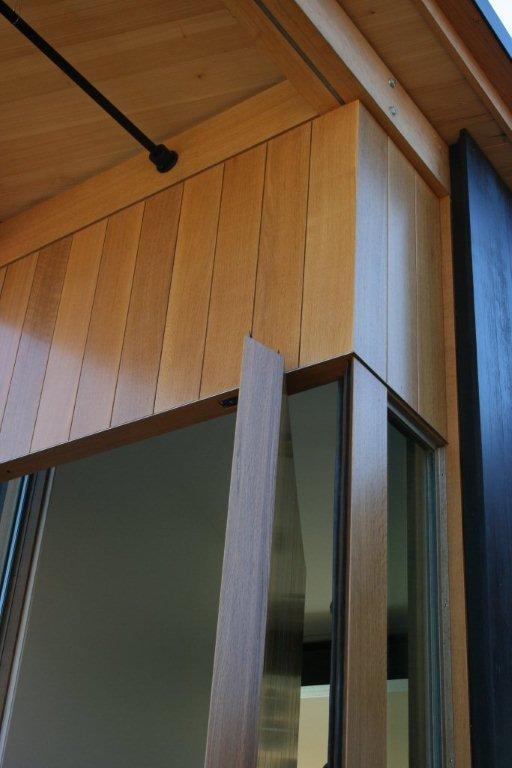Detail of seamless mitered corner at pivot door