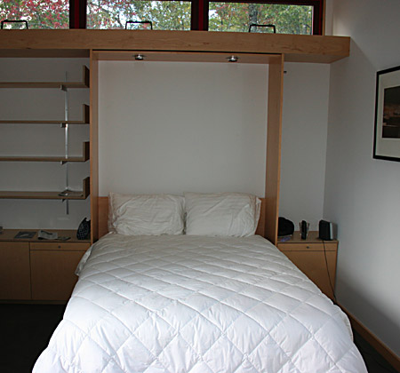 We built this contemporary bed and custom shelving.