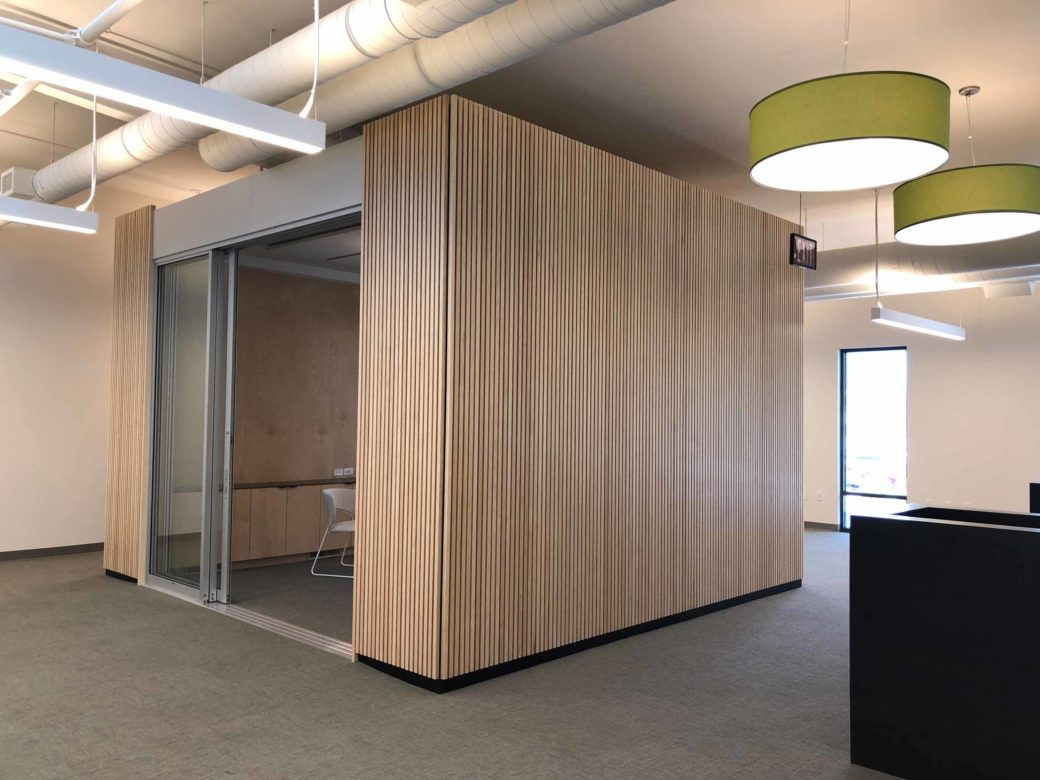 conference room with wood slat paneling