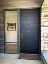 modern exterior door with dark stain