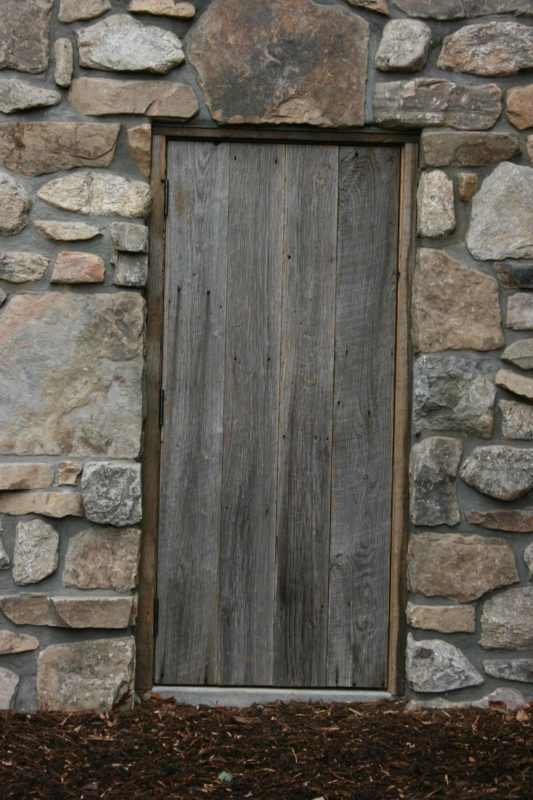rustic raw wood milkhouse door