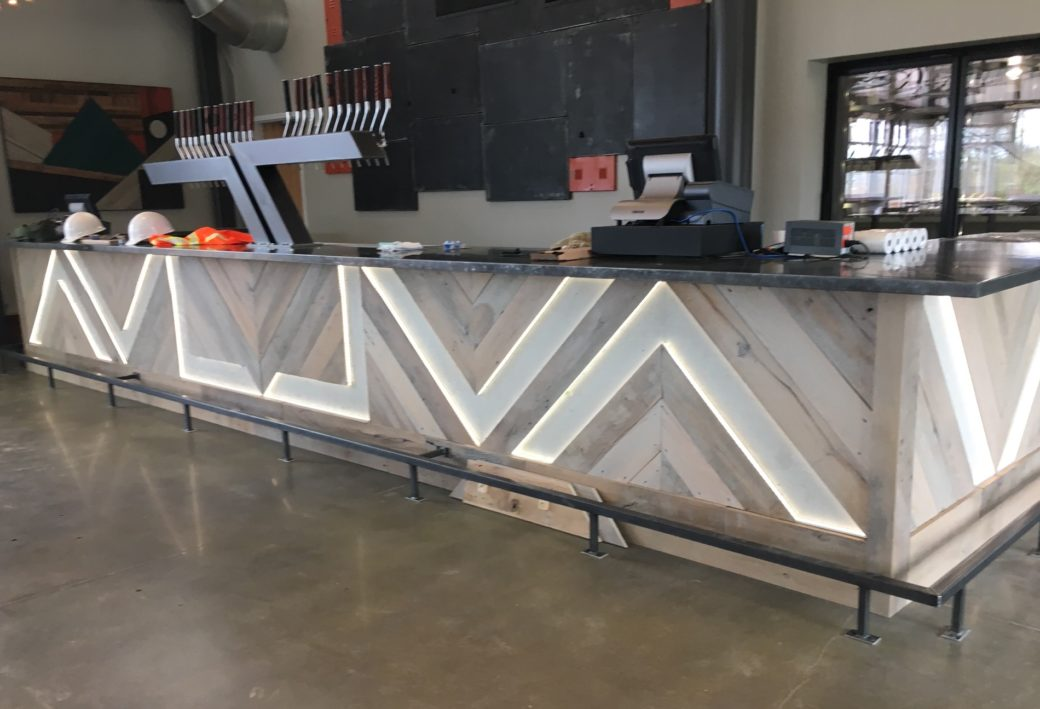 New Belgium brewery custom made reclaimed wood bar, with zinc top and LED lighting